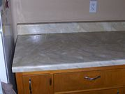 Kitchen counter tops decorated in faux paint finish Travertine French Vanilla
